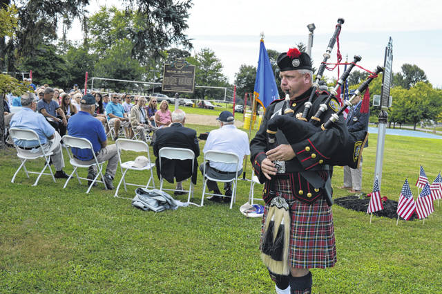 Ed Myers, the Goshen Deputy Fire Chief and former Wilmington firefighter, plays the bagpipes.