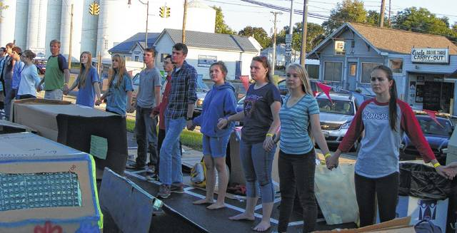 Cardboard City participants and advocates for the homeless at last year's Cardboard City form a human chain of hands around the northeast corner of the Clinton County Courthouse block. Pictured is part of the human chain that lined the Main Street side of courthouse square.