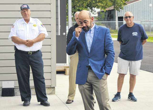 Former Speaker of the Ohio House of Representatives Cliff Rosenberger, center foreground, gets emotional during remarks at the ribbon-cutting. In the left background is Clinton-Warren Joint Fire Rescue District Chief Bob Wysong.