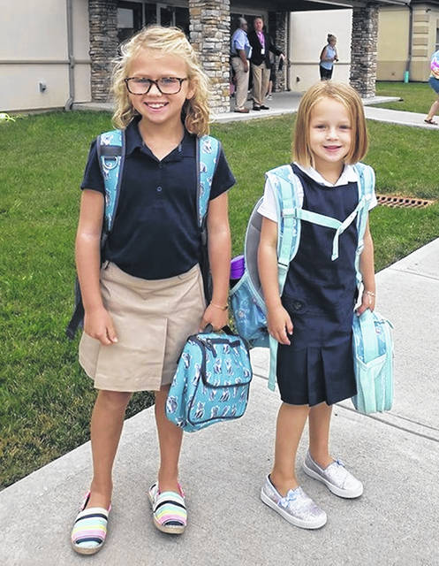 Third-grader Josey and first-grader Janey begin school at WCA.