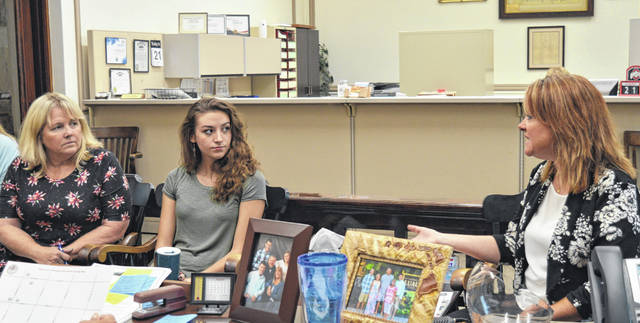 In the county commissioners office Wednesday from left are Main Street Wilmington staffers: Co-Director Darcy Reynolds, Wilmington College intern Sabrina Bowman, and Co-Director Ruth Brindle.