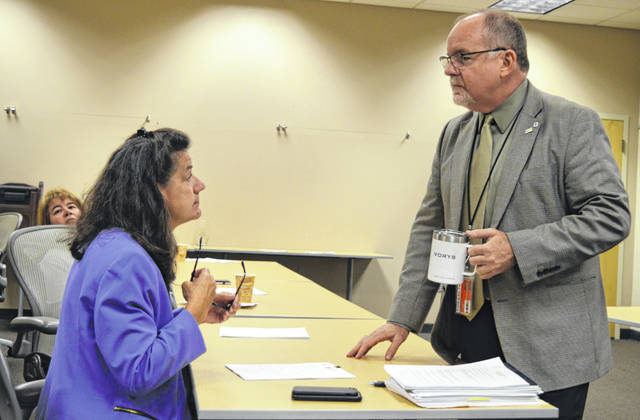 Prior to a Clinton County Port Authority board meeting Thursday morning, Port Authority Associate Director Beth Huber, left, and Executive Director Dan Evers take time to talk.