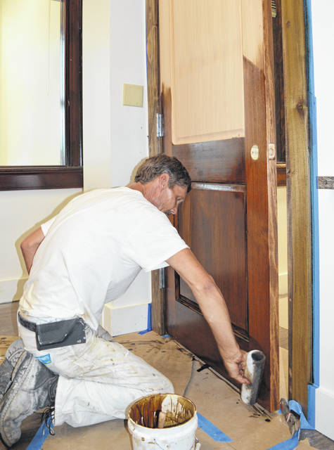 Work is nearing completion on re-configuring the former offices of the Clinton County Board of Elections at the Clinton County Courthouse. The new occupants of the space will be staffers with the Adult Probation Department which is a division of the Clinton County Common Pleas Court. In the photo Michael Durham with Tri State Interiors applies wood stain to a new door. Next on the to-do list at the courthouse is remodeling of the space currently occupied by Adult Probation, making way for the Clinton County Public Defender staff to relocate there. Earlier this year the board of elections moved to the County Annex Building located in Wilmington at 111 S. Nelson Ave. Suite #4 next to the Clinton County Health Department.
