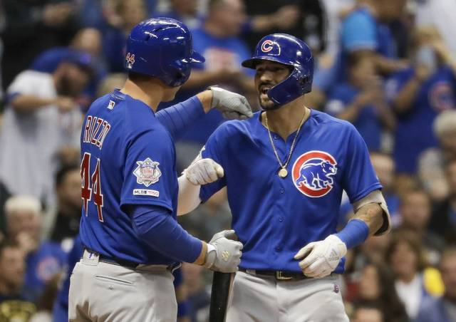 Chicago Cubs' Nicholas Castellanos is congratulated by Anthony Rizzo after hitting a home run during the third inning of a baseball game against the Milwaukee Brewers Friday, Sept. 6, 2019, in Milwaukee. (AP Photo/Morry Gash)