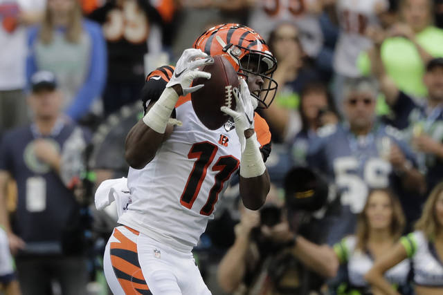 FILE - In this Sept. 8, 2019, file photo, Cincinnati Bengals wide receiver John Ross makes a catch for a touchdown during the first half of an NFL football game against the Seattle Seahawks, in Seattle. After two disappointing seasons cut short by injuries and a missed training camp, Bengals receiver John Ross has his breakout game, one of the most encouraging things for Cincinnati in its opener. (AP Photo/John Froschauer, File)