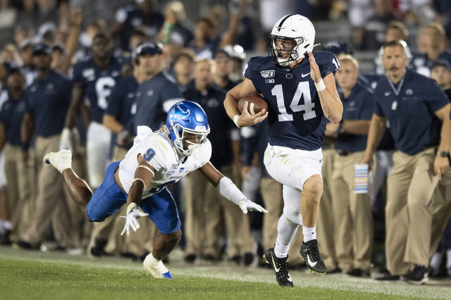 Penn State quarterback Sean Clifford (14) sprints away from Buffalo safety Joey Banks (9) on along gain during the third quarter of an NCAA college football game in State College, Pa., Saturday, Sept. 7, 2019. (AP Photo/Barry Reeger)