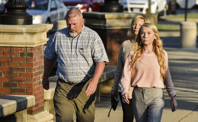 "Brooke ""Skylar"" Richardson, right, walks with her parents, Kim and Scott Richardson, before closing arguments in her trial at Warren County Common Pleas Court Thursday, Sept. 12, 2019 in Lebanon, Ohio. Richardson, accused of killing and burying her newborn daughter,  has pleaded not guilty to aggravated murder and other charges. (Nick Graham/The Journal-News via AP)"