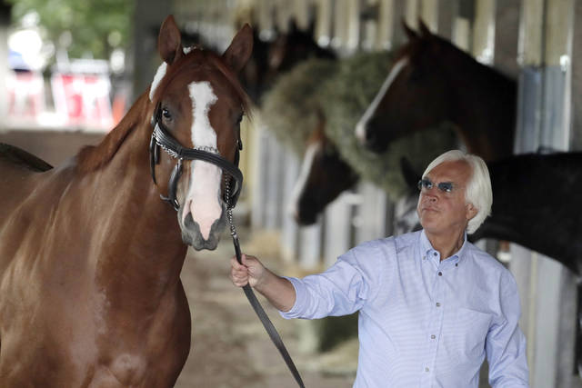 FILE - In this June 6, 2018, file photo, trainer Bob Baffert walks Justify around the barn after arriving at Belmont Park in Elmont, N.Y. Attorney W. Craig Robertson, a lawyer for Baffert said Thursday, Sept. 12, 2019, that the Hall of Fame trainer did not intentionally give 2018 Triple Crown winning horse Justify a banned substance that caused a positive test prior to the Kentucky Derby. Robertson contends the substance came from contaminated food. (AP Photo/Julio Cortez, File)