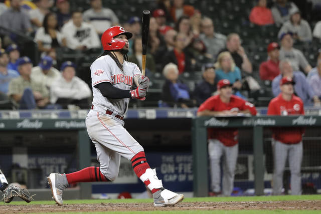 Cincinnati Reds' Freddy Galvis watches his grand slam in the seventh inning of the team's baseball game against the Seattle Mariners, Thursday, Sept. 12, 2019, in Seattle. (AP Photo/Ted S. Warren)