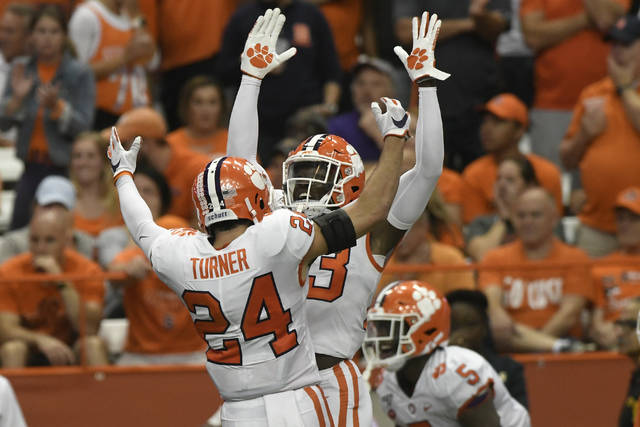 Clemson players Nolan Turner and Lyn-J Dixon celebrate a touchdown against Syracuse during an NCAA college football game Saturday, Sept. 14, 2019, in Syracuse, N.Y. (AP Photo/Steve Jacobs)