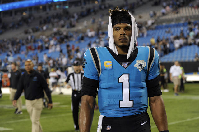 Carolina Panthers quarterback Cam Newton (1) walks off the field following the Panthers 20-14 loss to the Tampa Bay Buccaneers following an NFL football game in Charlotte, N.C., Friday, Sept. 13, 2019. (AP Photo/Mike McCarn)