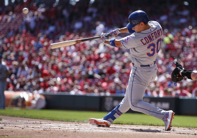New York Mets' Michael Conforto hits a three-run home run off Cincinnati Reds starting pitcher Trevor Bauer during the first inning of a baseball game, Sunday, Sept. 22, 2019, in Cincinnati. (AP Photo/Gary Landers)