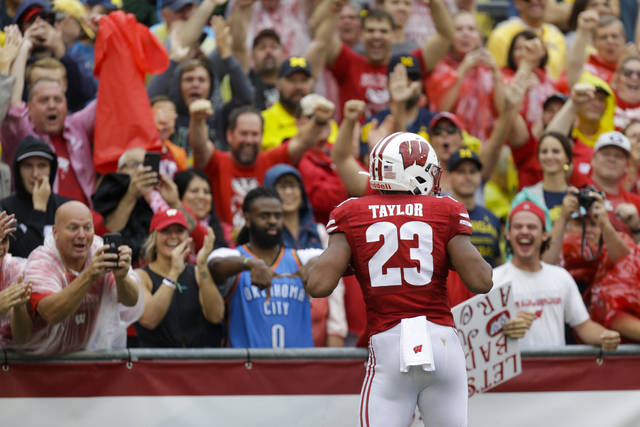 Wisconsin running back Jonathan Taylor celebrates a touchdown against Michigan during the first half of an NCAA college football game Saturday, Sept. 21, 2019, in Madison, Wis. (AP Photo/Andy Manis)