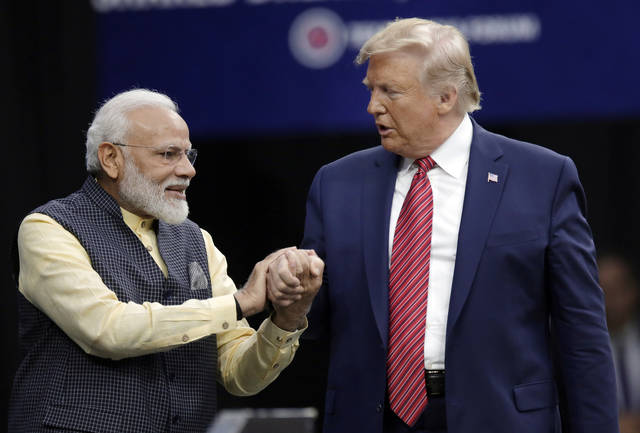 "Prime Minister Narendra Modi and President Donald Trump shake hands after introductions during the ""Howdi Modi"" event Sunday, Sept. 22, 2019, at NRG Stadium in Houston. (AP Photo/Michael Wyke)"