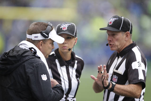 New Orleans Saints head coach Sean Payton, left, talks with officials during the first half of an NFL football game against the Seattle Seahawks, Sunday, Sept. 22, 2019, in Seattle. (AP Photo/Scott Eklund)