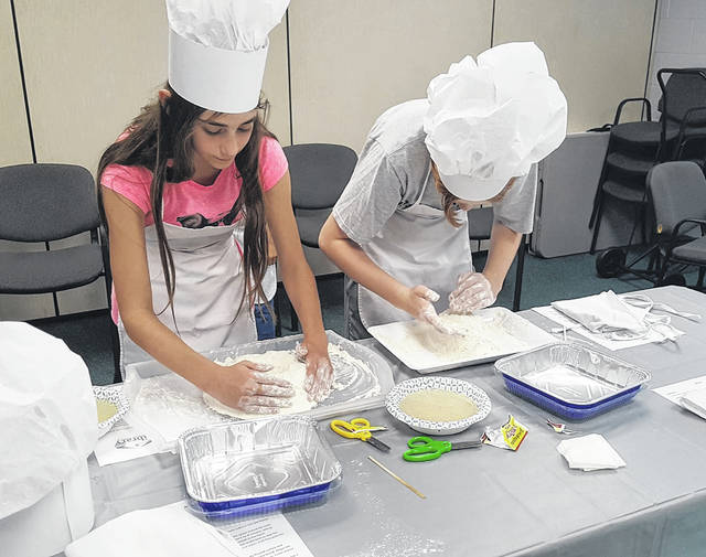 """Young bakers learn the basics of bread making at the Wilmington Public Library's new youth program: """"Fun Life Stuff."""" For more photos of the event, see wnewsj.com."""