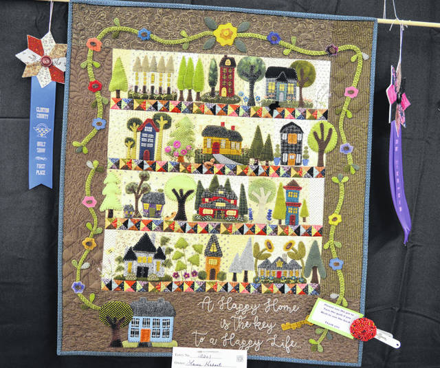 "Laura Hobart made the quilt that was judged Best of Show in the Clinton County Quilt Show at the 2019 Clinton County Corn Festival. The quilt pattern is ""Happy Home""."