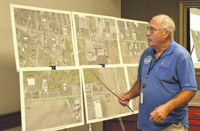 Wilmington Mayor John Stanforth utilizes a pointer and a series of maps to elaborate upon the Rombach Avenue project.