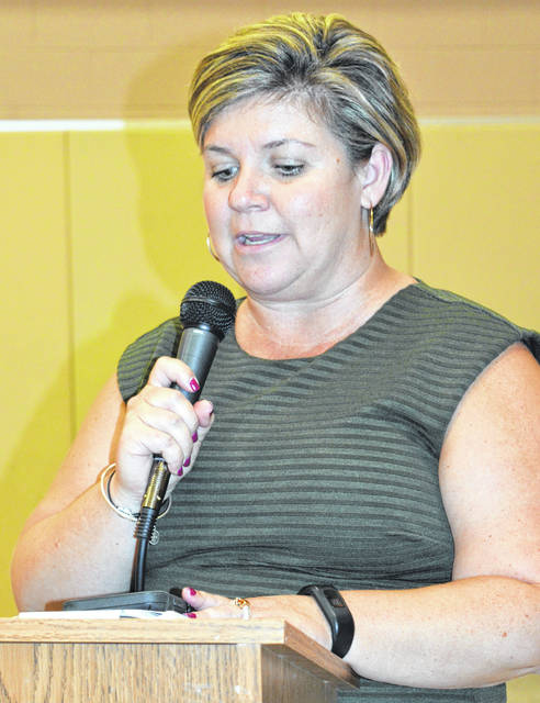 Holmes Elementary School Principal Marilee Tanner, Ed.D., delivers a report Monday night to the school board.