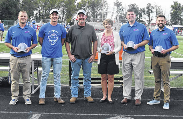 "Prior to Friday night's Clinton-Massie football game, the school district recognized a $25,000 competitive grant it was awarded. It will be used to build a greenhouse and create a ""Growing Entrepreneurs"" program. The Grow Rural Education program, sponsored by the Bayer Fund, provides grants to help enhance STEM (science, technology, engineering, and math) education. From left are Clinton-Massie High School Principal Aaron Seewer, high school agriculture teacher Tyler Uetrecht, community member Matt Lamb, community member Lynn Deatherage, Superintendent Matt Baker, and Clinton-Massie High School Assistant Principal Jay Reynolds. Six farmers nominated the school district for the grant, and Lamb and Deatherage are two of them. Once Clinton-Massie was nominated, Clinton-Massie K-5 Gifted Intervention Specialist Jen Molitor applied for the grant."