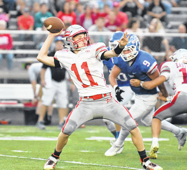 East Clinton's Jared Smith (11) attempts a pass during the game last week against Clinton-Massie.