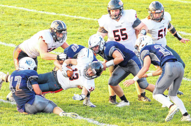 Blanchester's James Peters (47), Jacob Lanham (60), Colt Conover (6) and Gage Huston (21) during last week's game against Waynesville.