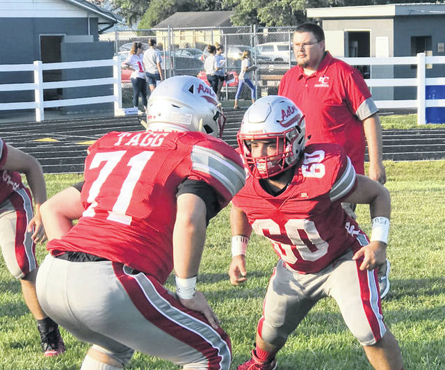 East Clinton first-year head coach Steven Olds (right) has the Astros playing well through the first half of the season. In the photo is Garrett Elzey (60) and Seth Tagg (71).