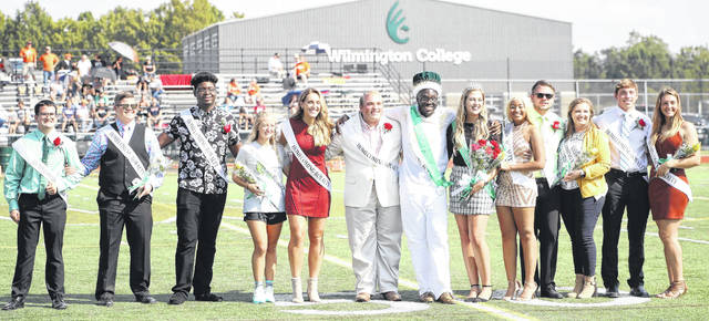 The Wilmington College Homecoming Court for 2019 includes, from left, Adrian Salamone, Alyssa Harper, Darron Crump, Abigail Spirk, Jillian Wesco, Jese Shell, Brandon Ford (King), Jen Cochran (Queen), Alaunna Nelson, Kameron Rinehart, Aryn Copeland, Logan Schroer, and Hayley Suchland. Record crowds of students, alumni and friends enjoyed a weekend packed with reunions, special recognition, sports, games and other activities designed to bring them closer to their alma mater.