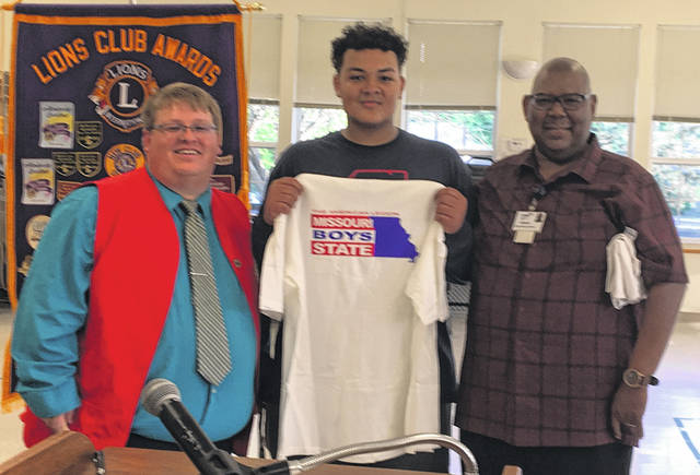 Two young men who attend Buckeye Boys State this summer representing Wilmington High School — Donovan Butler Jr. and Tramail Hollins — thanked their Buckeye Boys State sponsors and spoke of their appreciation to the sponsors and their experience at Buckeye Boys State. Shown, Tramail Hollins thanks the Wilmington Lions Club as he was surprised by being made an Honorary Missouri Boys Stater. He is with Lions Club President Ryan Page and Buckeye Boys State Board Member Vermon L. Dillon.