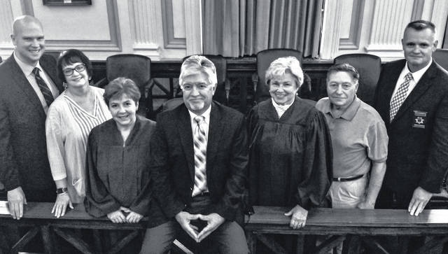 From left are Kirk Neuenschwander, Beth Klemetzen, Helen Rowlands, Tim Rudduck, Mary McElwee, Ken Houghtaling, and Kelly Hopkins.