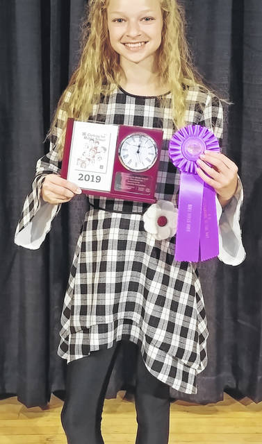 Kensey Parker of Clinton County was awarded a clock trophy after winning the Clothing for Middle School sewing category at the Ohio State Fair.