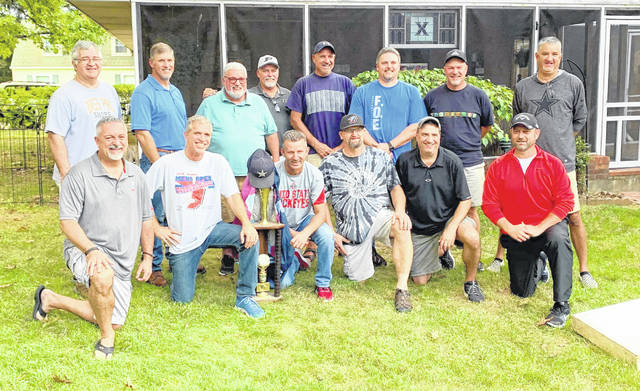 In the reunion photo, from left to right, front row, Chris Wagner, Michael Snarr, Mark Young, Brian Camp, Tony Butcher, Cam Storer; back row, Kenny Williamson, Roger Wilt, Keith Livingston, Ronnie Brooks, Johnny Haley, Ray Camp, Paul McDonald, Jerry Butcher. Team member Terry Brewer was not present for the photo.