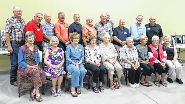 The Simon Kenton Classes of 1962 and 1963 met Saturday at the Cove in Sabina over lunch by All Seasons Catering of Leesburg. Pictured from left in the first row from the Class of 1963 are Belinda Brackney Cook, Cheryl Custis Locke, and Sandy Vineyard Luttrell; from the Class of 1962 are Mary Swisshelm Massey, Connie Collingham Wilson, Patti Easter, Karen Gullett Collett, Nancy Gibbs Graves, and Karen Tibbles Ollerin the back row, from the Class of '63 are Jerry Bennett, Butch Hooper, Jim McClary, Merle Henry, and Max Thatcher; and from the Class of '62 are John Roberts, Roger Bentley, Gary Thatcher, Ken Ellis, and Charlie Smith.