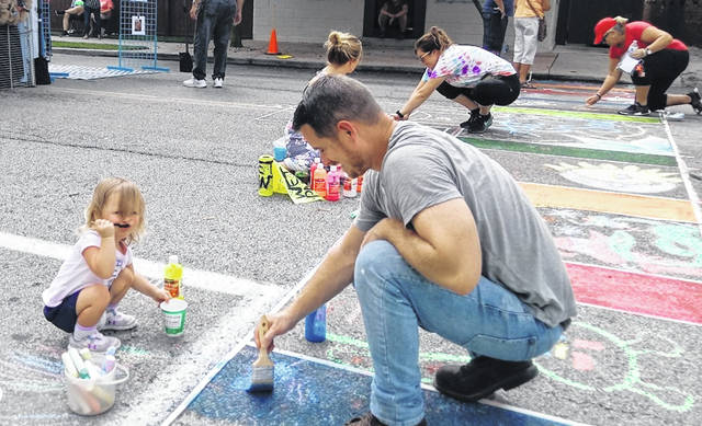 Things were hot all around Saturday including at the Art & Soul Festival on Sugartree Street in Wilmington, which included street art for all ages.