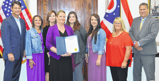 Clinton County commissioners on Wednesday proclaimed October as Domestic Violence Awareness Month in the county. They were joined by staff from the Alternatives to Violence Center that has offices in Wilmington and Hillsboro. From left are Clinton County Commissioner Kerry Steed, Lynn Knisley, Nicole Hopkins, Alternatives to Violence Director Dara Gullette holding certificate, Carrie Christie, Jessica Aber, and Clinton County Commissioners Brenda Woods and Mike McCarty.