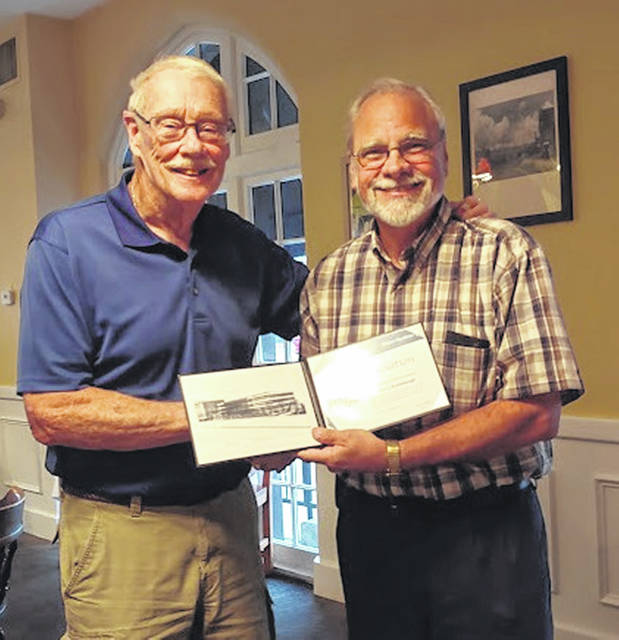 From left are Home Town Hero Harry Brumbaugh and Chapter Coordinator Dan Mayo.