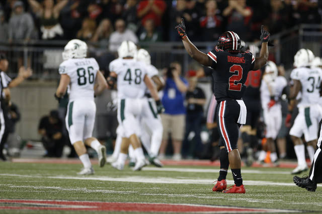 Ohio State running back J.K. Dobbins, right, celebrates an Ohio State touchdown against Michigan State during the first half of an NCAA college football game Saturday, Oct. 5, 2019, in Columbus, Ohio. (AP Photo/Jay LaPrete)