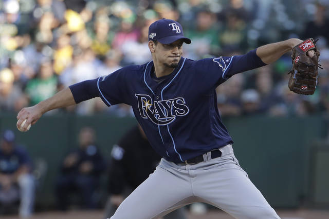 Tampa Bay Rays pitcher Charlie Morton throws to an Oakland Athletics batter during the first inning of an American League wild-card baseball game in Oakland, Calif., Wednesday, Oct. 2, 2019. (AP Photo/Jeff Chiu)
