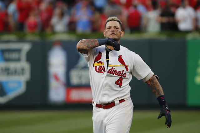 St. Louis Cardinals' Yadier Molina celebrates after hitting a sacrifice fly to score Kolten Wong and defeat the Atlanta Braves in Game 4 of a baseball National League Division Series, Monday, Oct. 7, 2019, in St. Louis. (AP Photo/Jeff Roberson)