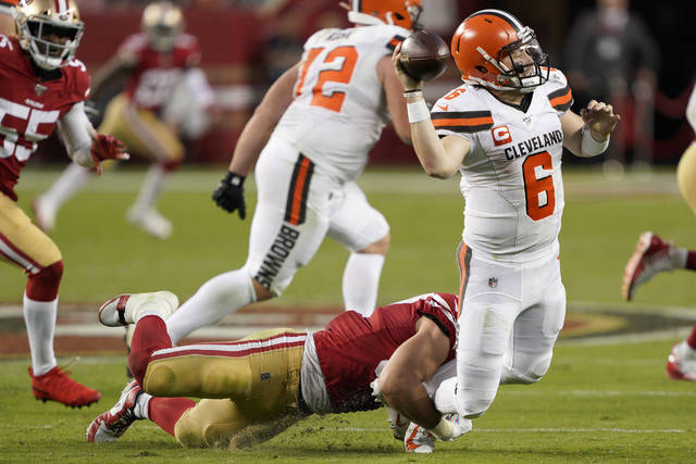 Cleveland Browns quarterback Baker Mayfield (6) throws the ball away as San Francisco 49ers defensive end Nick Bosa tries to tackle him during the first half of an NFL football game in Santa Clara, Calif., Monday, Oct. 7, 2019. (AP Photo/Tony Avelar)