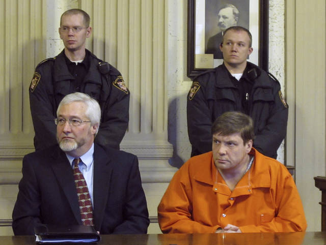 FILE - In this Jan. 25, 2012 file photo, Ken Richey, lower right, sits with attorney Greg Meyers during a court appearance in Ottawa, Ohio. Richey, a Scotsman who was released after two decades on Ohio's death row, has again been charged with threatening a former assistant prosecutor. The Lima News reports Richey pleaded not guilty to retaliation charges Thursday, Oct. 10, 2019.  (AP Photo/John Seewer, File)