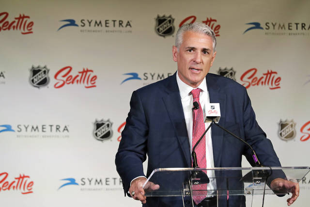 File-This July 18, 2019, file photo shows Ron Francis talking to reporters, in Seattle after he was introduced as the first general manager for Seattle's yet-to-be-named NHL hockey expansion team. Now that he is a couple months into the job, Francis has gained a little more of an appreciation for the task he signed up for. The easy decision for the 56-year-old and Hockey Hall of Famer would have been to take a consulting or scouting gig, keep his family settled in North Carolina and not taken on the kind of challenge that may eventually define his post-playing career. (AP Photo/Ted S. Warren, File)