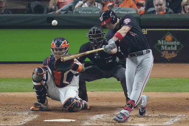 Washington Nationals' Ryan Zimmerman hits a home run during the second inning of Game 1 of the baseball World Series against the Houston Astros Tuesday, Oct. 22, 2019, in Houston. (AP Photo/Eric Gay)