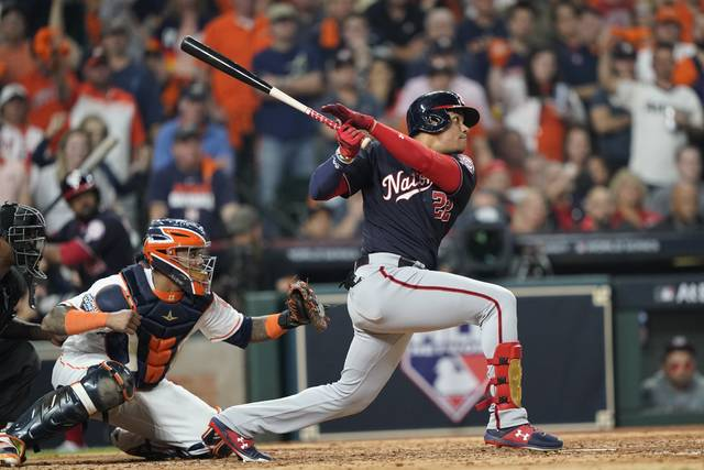 Washington Nationals' Juan Soto hits a two-run scoring double during the fifth inning of Game 1 of the baseball World Series against the Houston Astros Tuesday, Oct. 22, 2019, in Houston. (AP Photo/David J. Phillip)