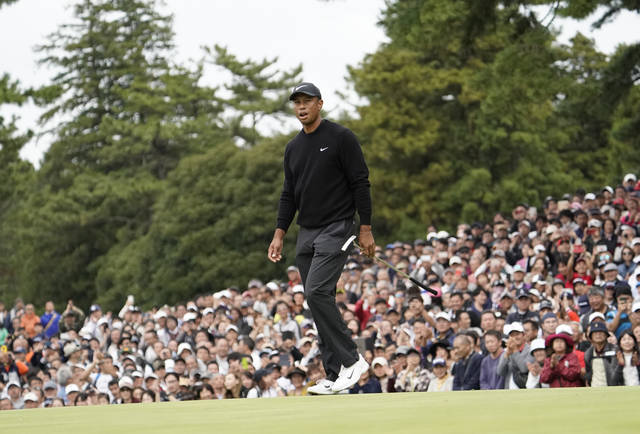 Tiger Woods of the United States walks on the 9th hole after finishing the first round of the Zozo Championship PGA Tour at the Accordia Golf Narashino country club in Inzai, east of Tokyo, Japan, Thursday, Oct. 24, 2019. (AP Photo/Lee Jin-man)