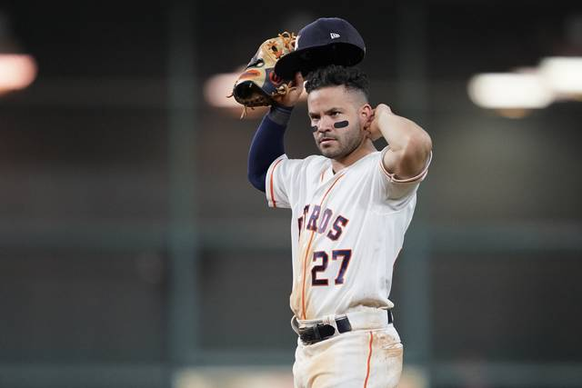 Houston Astros' Jose Altuve reacts during the eighth inning of Game 2 of the baseball World Series against the Washington Nationals Wednesday, Oct. 23, 2019, in Houston. (AP Photo/David J. Phillip)