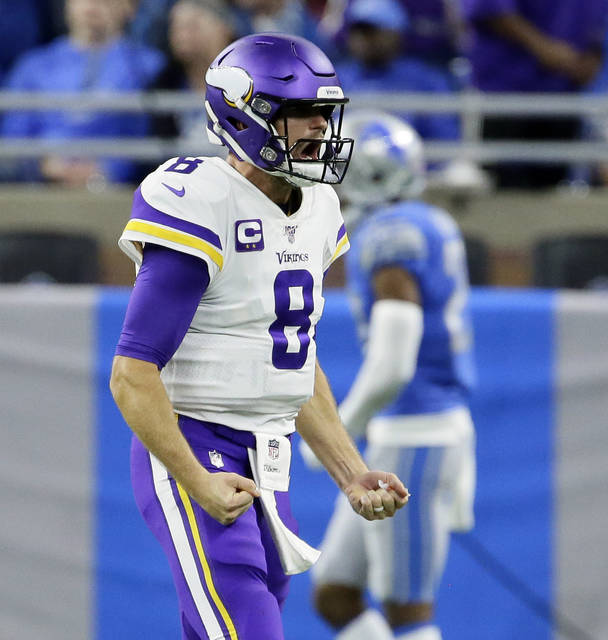 Minnesota Vikings quarterback Kirk Cousins reacts after a touchdown during the second half of an NFL football game against the Detroit Lions, Sunday, Oct. 20, 2019, in Detroit. (AP Photo/Duane Burleson)