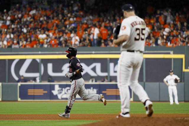 Washington Nationals' Kurt Suzuki rounds the bases after a home run off Houston Astros starting pitcher Justin Verlander during the seventh inning of Game 2 of the baseball World Series Wednesday, Oct. 23, 2019, in Houston. (AP Photo/Matt Slocum)