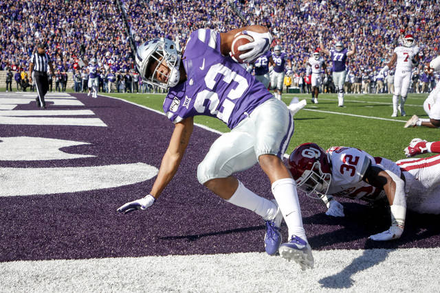 Kansas State wide receiver Joshua Youngblood (23) scores a touchdown against Oklahoma safety Delarrin Turner-Yell (32) during the first half of an NCAA football game at Bill Snyder Family Stadium in Manhattan, Kan., Saturday, Oct. 26, 2019. (Ian Maule/Tulsa World via AP)