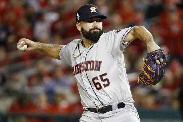 Houston Astros starting pitcher Jose Urquidy throws against the Washington Nationals during the first inning of Game 4 of the baseball World Series Saturday, Oct. 26, 2019, in Washington. (AP Photo/Patrick Semansky)